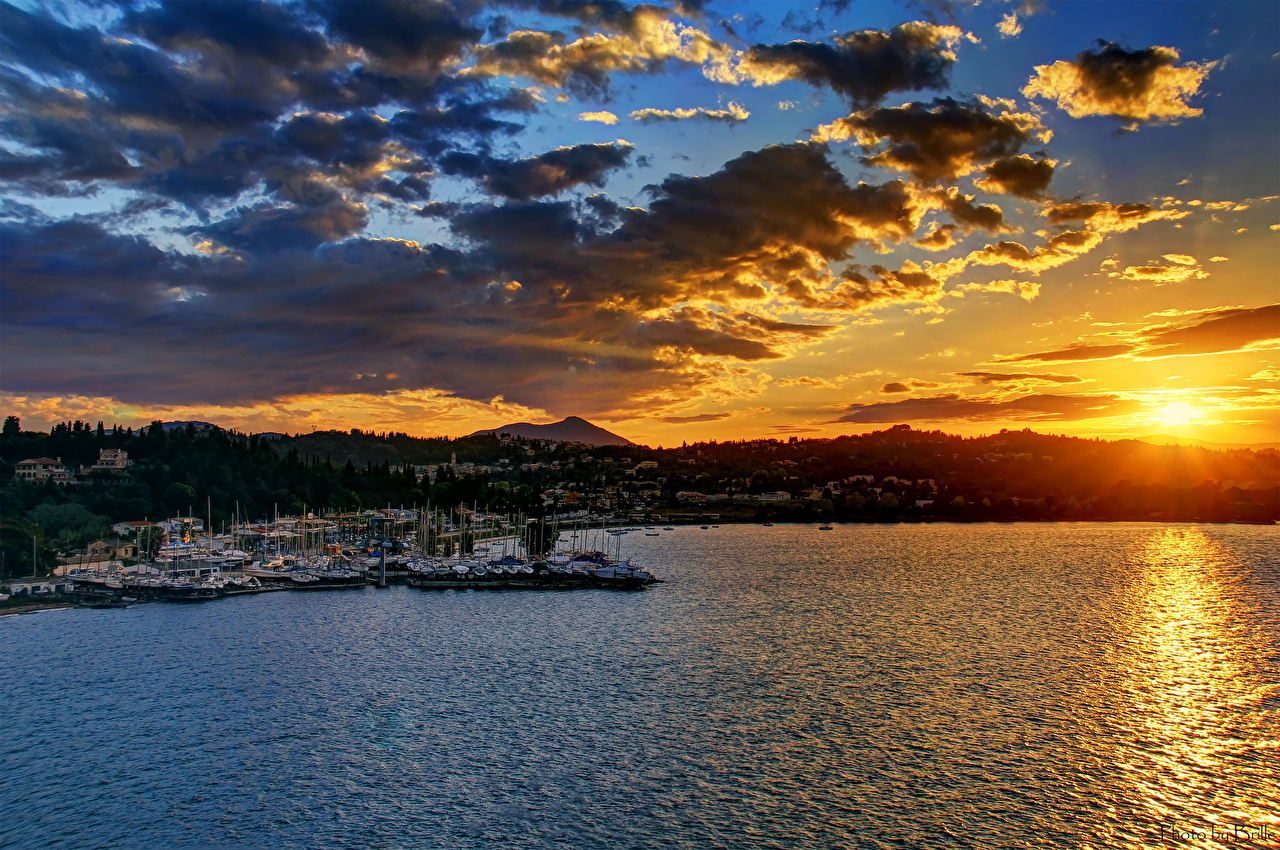 Images Greece Sun Sky Sunrises and sunsets Coast Water Clouds Cities sunrise and sunset