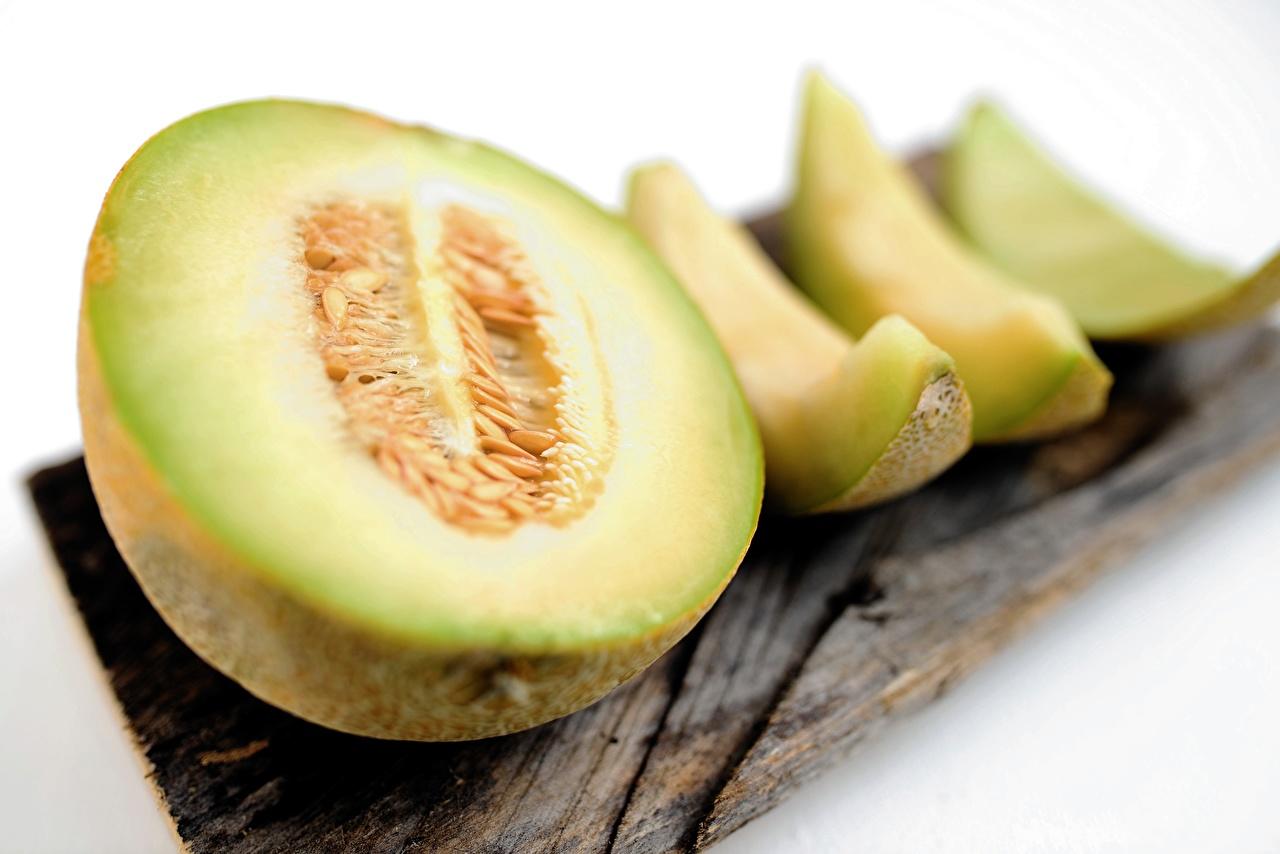 En gros plan Melon Bokeh Aliments en tranches aliments, tranchées, arrière-plan flou Nourriture