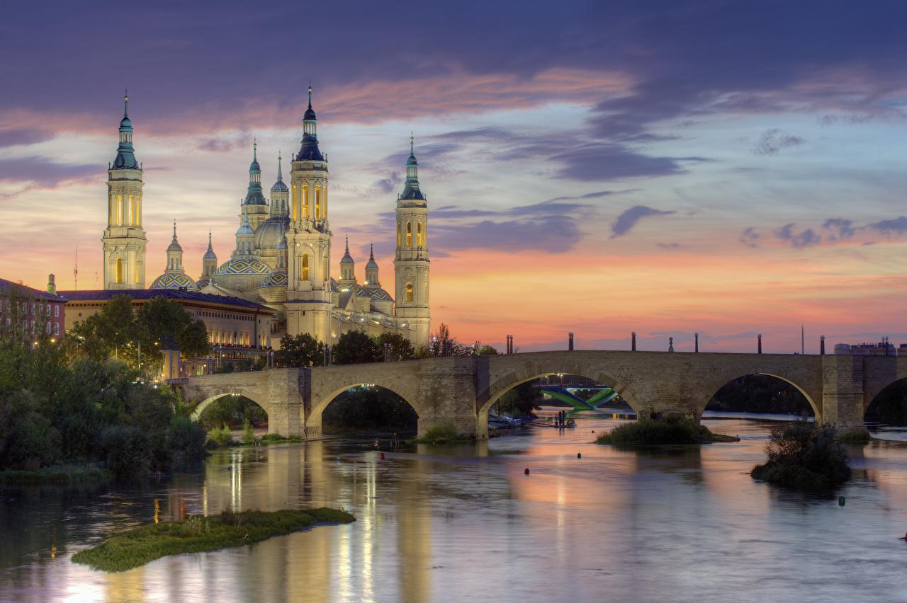 Images Spain Bridges sunrise and sunset river temple Evening Cities bridge Sunrises and sunsets Rivers Temples