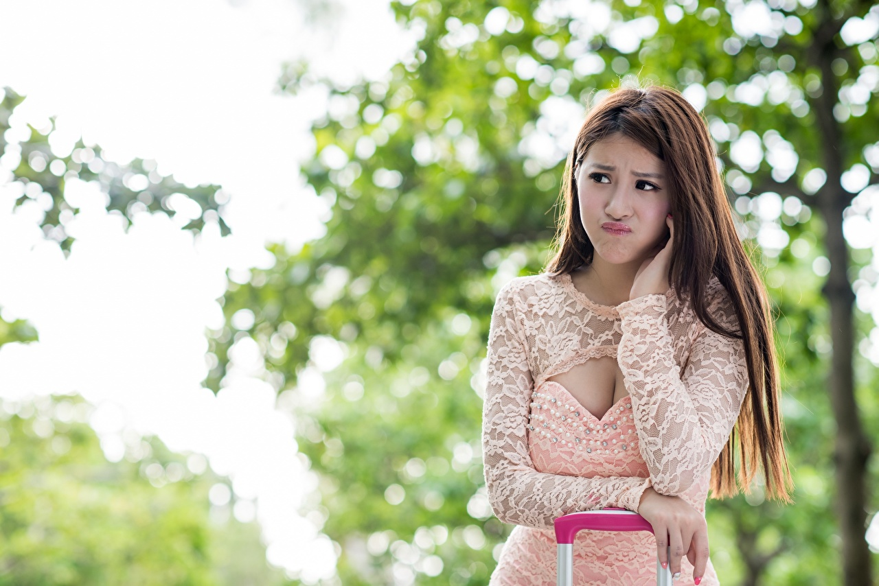 Picture Brown haired frown Bokeh Girls Asian Hands Staring Frowning displeased dissatisfied blurred background female young woman Asiatic Glance