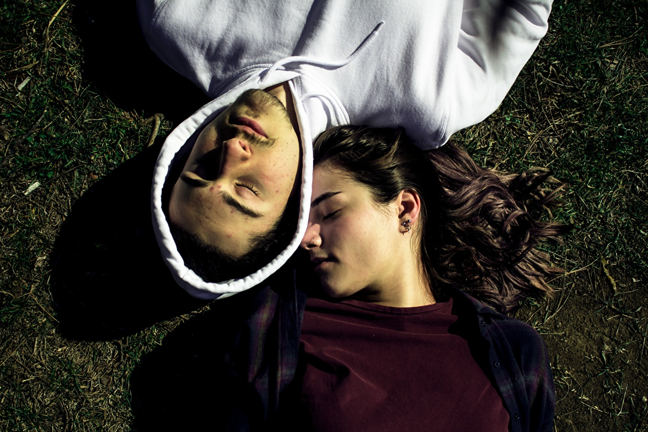 Images Brunette girl Men lovers esting 2 Sleep female From above Hood headgear Man Couples in love laying Lying down Two Girls sleeping young woman hooded