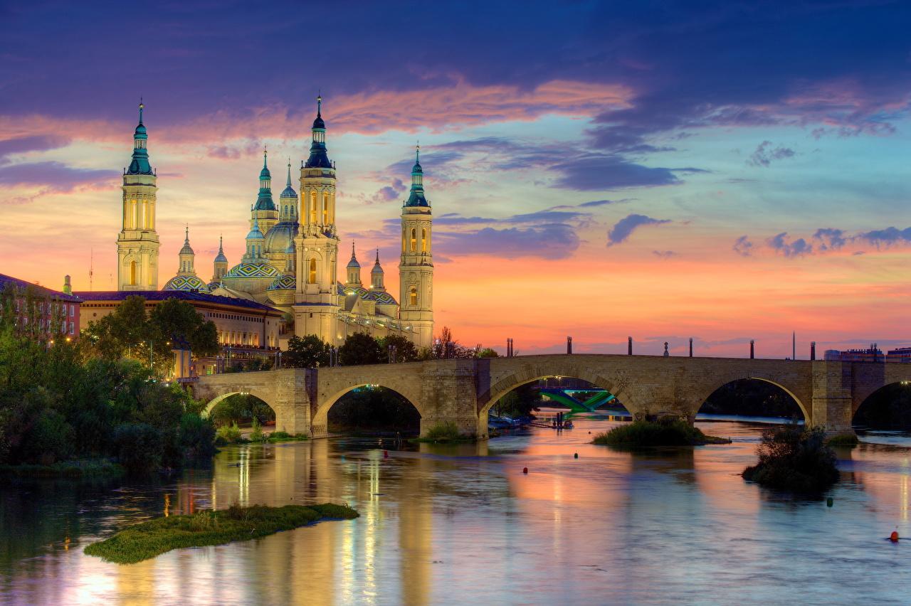 壁紙 スペイン 橋 川 朝焼けと日没 Zaragoza 都市 ダウンロード 写真