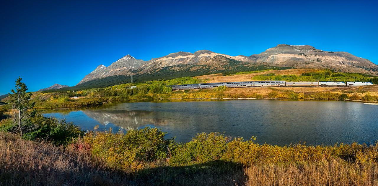 Tapeta na pulpit USA Glacier National Park Góry jesienne przyroda park Jezioro Pociąg stany zjednoczone góra Natura Jesień Parki pociągi