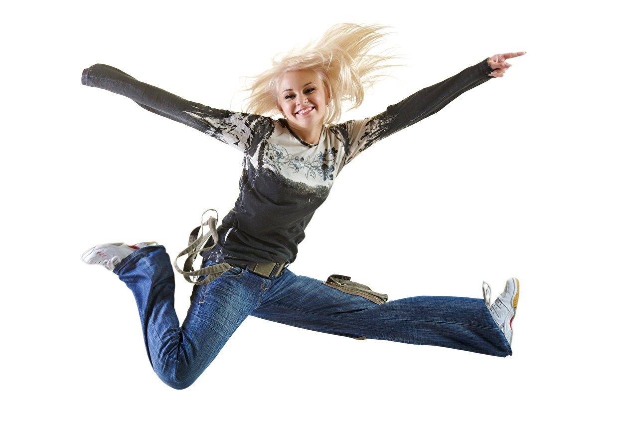 Image Blonde girl Joy Smile female Jump Jeans White background happy joyful Girls young woman