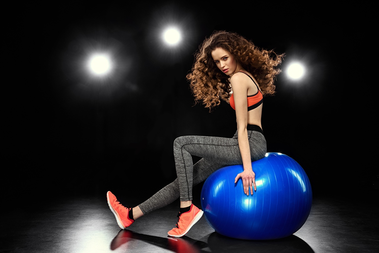 Wallpaper Brown haired Fitness young woman Legs sit Ball Hands Girls female Sitting