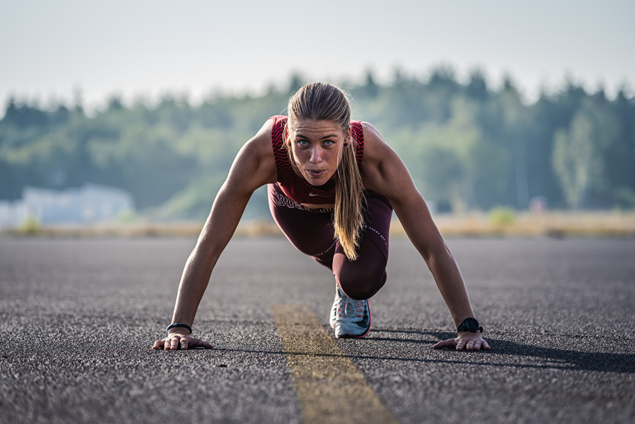 Picture Run Start Bokeh Pose Sport female Asphalt Staring Running blurred background posing Girls sports athletic young woman Glance