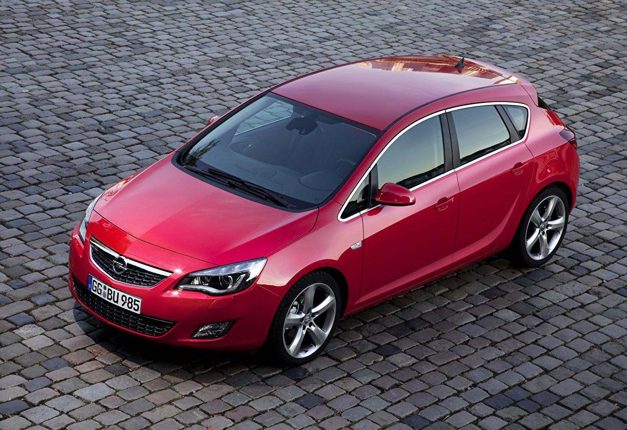 Desktop Hintergrundbilder Opel 2009-12 Astra Rot Autos Metallisch auto automobil