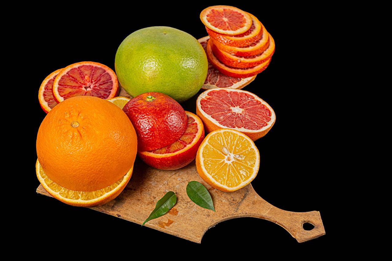 Picture Lime Grapefruit Orange fruit Food Cutting board Citrus Black background