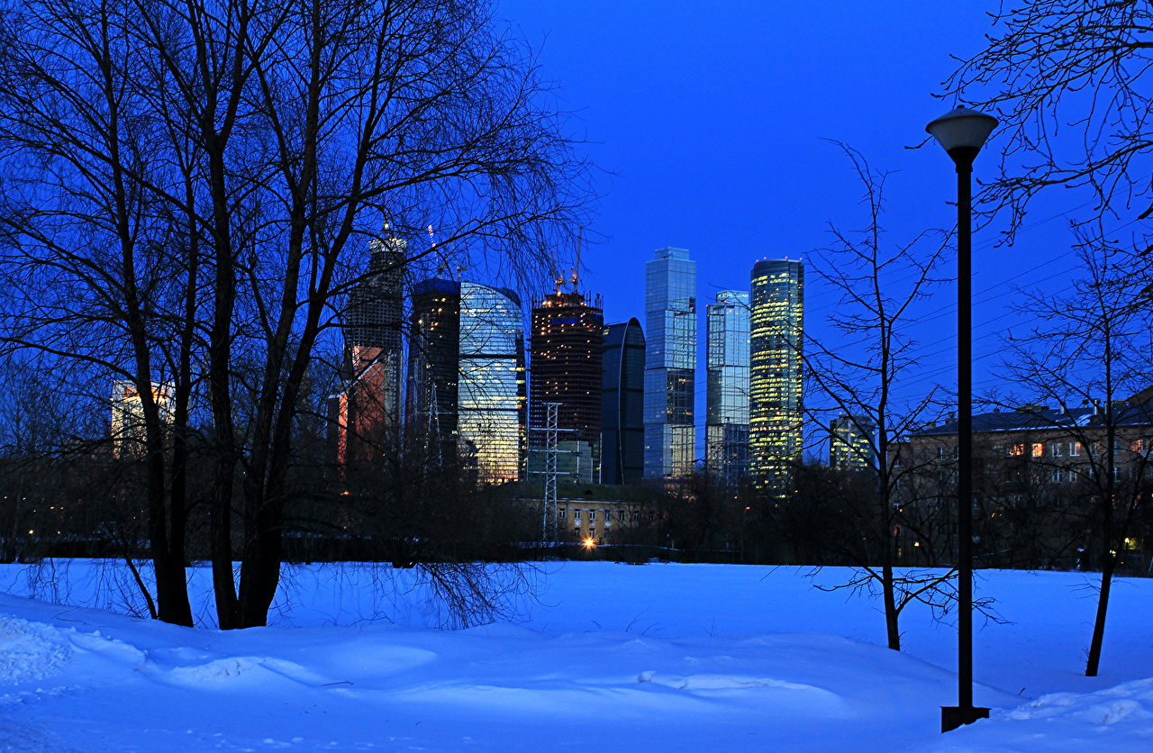 Photo Moscow Russia Winter Snow night time Street lights Trees Houses Cities Night Building