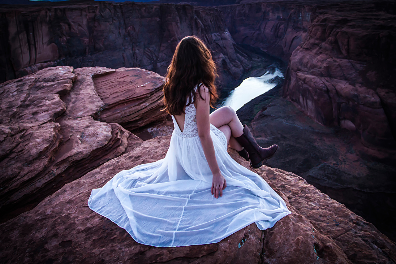 Photo River Throne Rock female Sitting Dress Crag Cliff Girls young woman sit gown frock