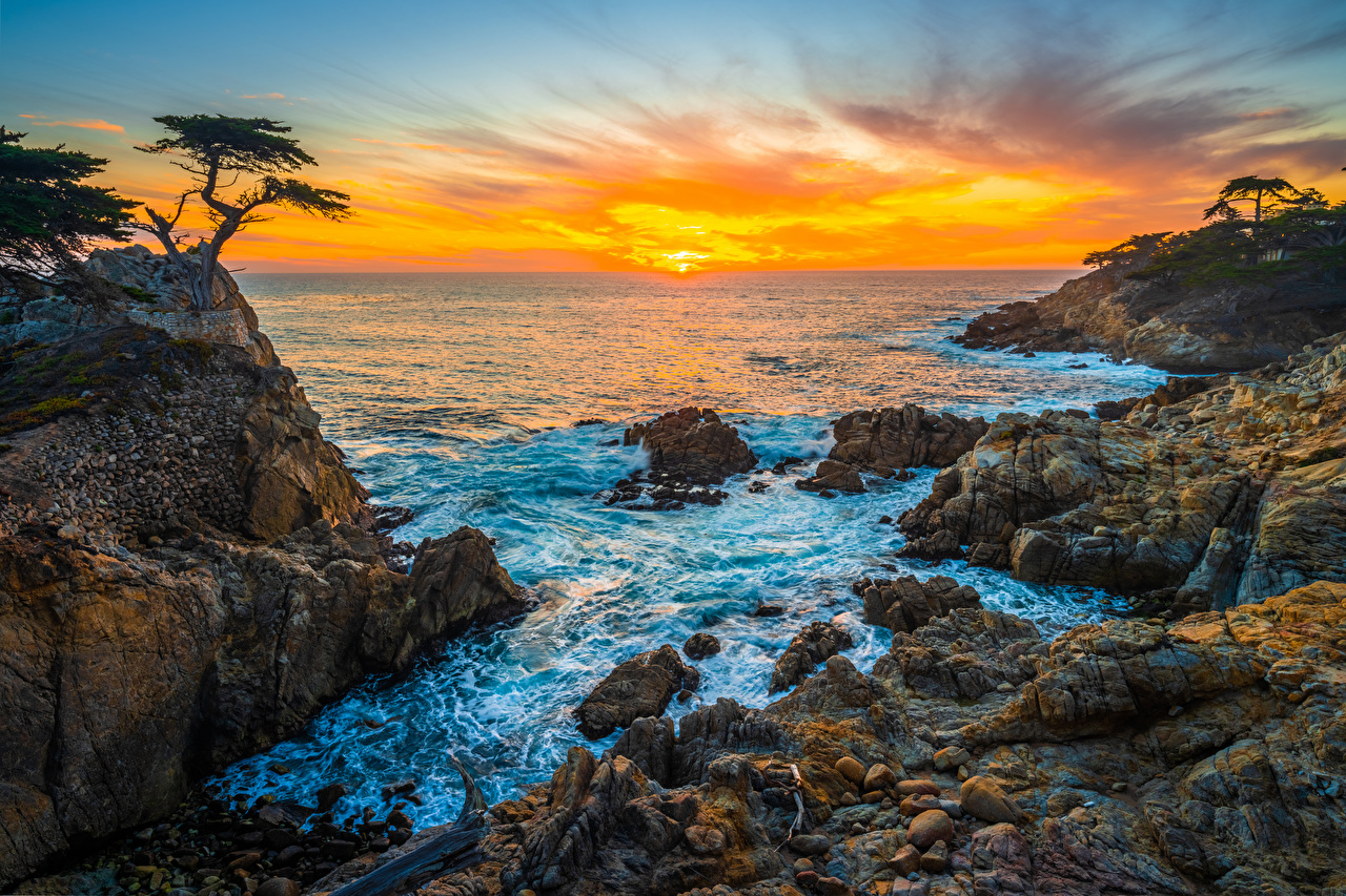 Photo California USA Pebble Beach Rock Ocean Nature Sunrises and sunsets Coast stone Crag Cliff sunrise and sunset Stones