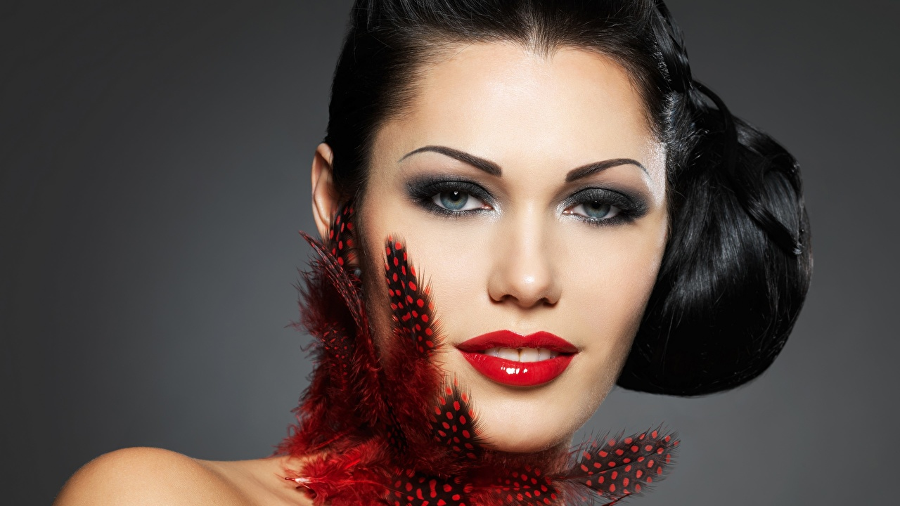 Image Brunette girl Makeup Face Girls Feathers Glance Red lips Gray background female young woman Staring