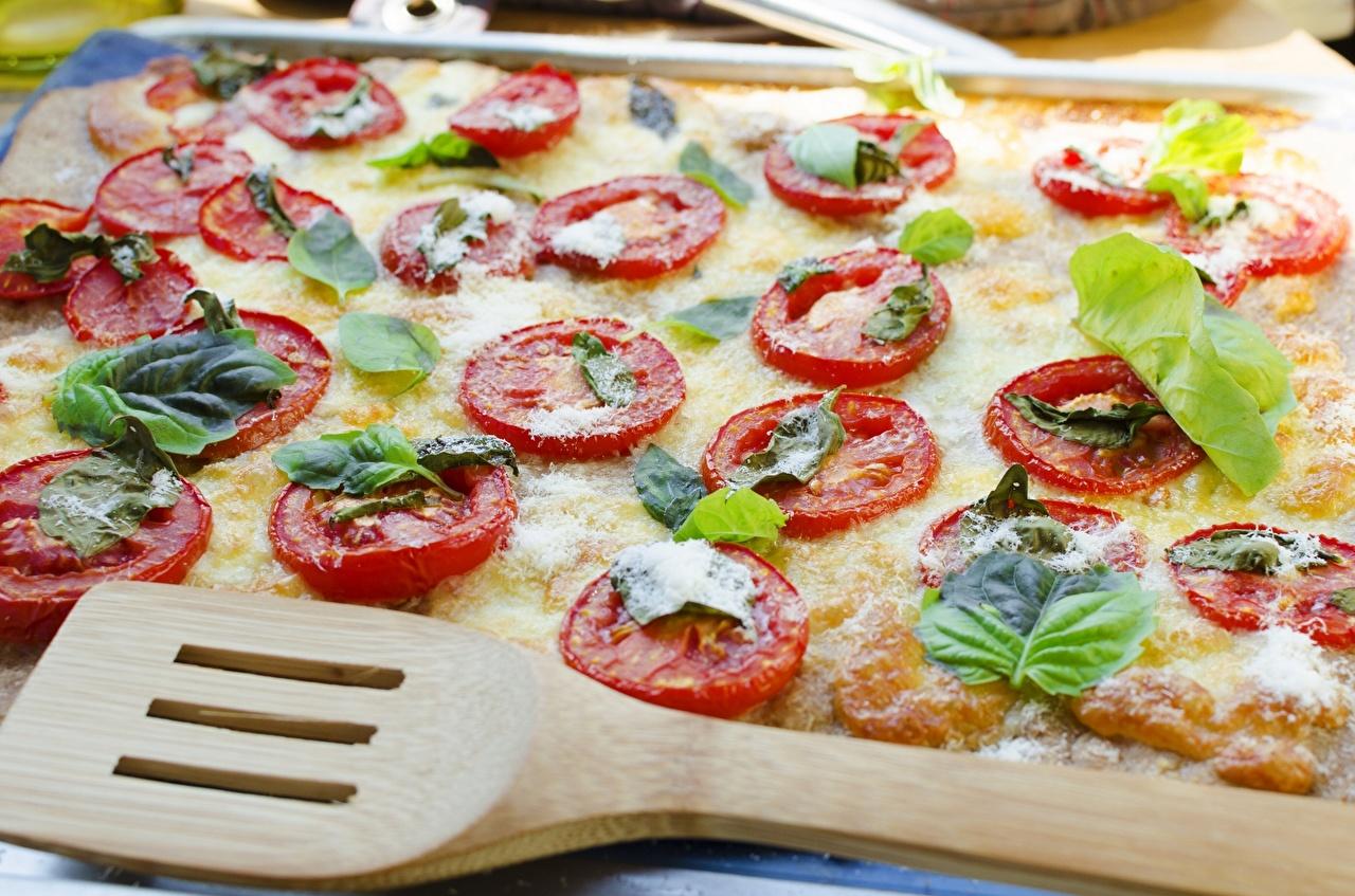 Bilder Pizza Tomaten das Essen Backware Großansicht Tomate Lebensmittel hautnah Nahaufnahme