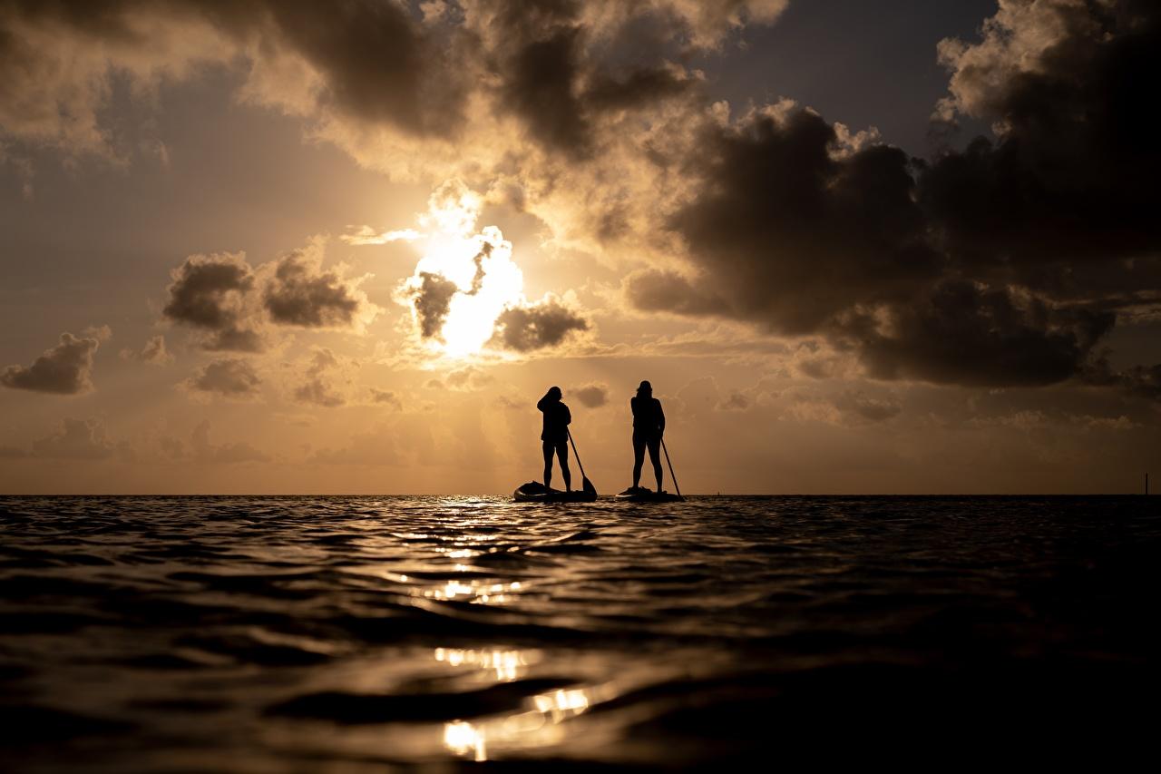 Afbeeldingen Silhouet De zee Twee 2 Natuur Zonsopgangen en zonsondergangen silhouetten