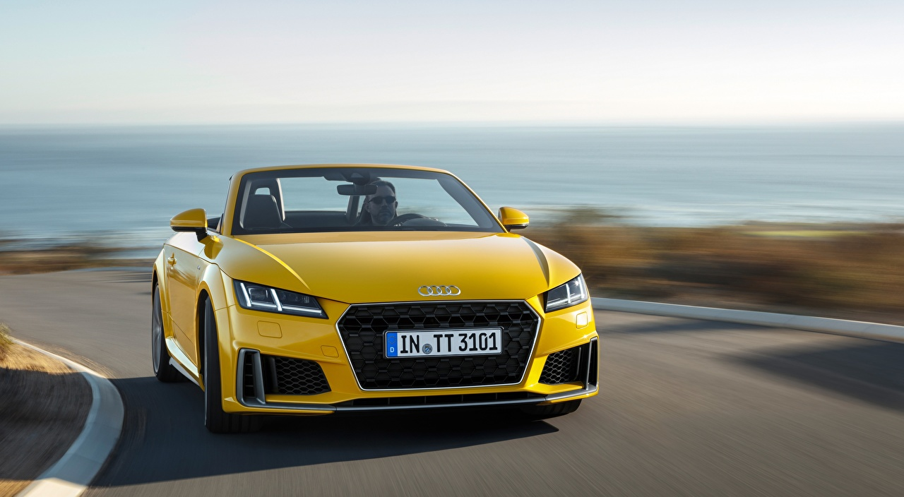 Photo Audi Bokeh Roadster Yellow at speed auto Front blurred background moving riding Motion driving Cars automobile