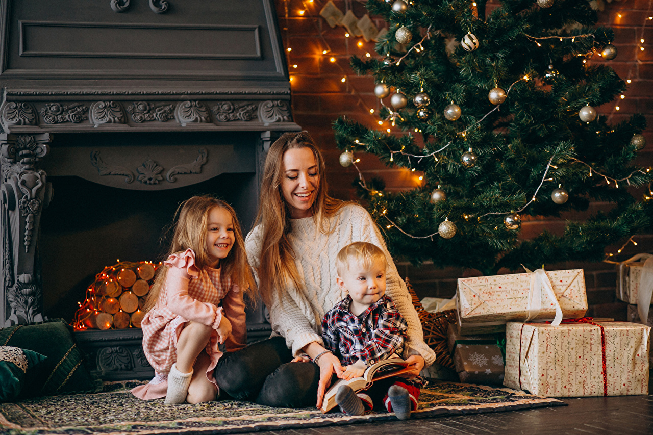 Photos Little girls Boys Christmas Mother child New Year tree present Three 3 Fairy lights New year Children Christmas tree Gifts