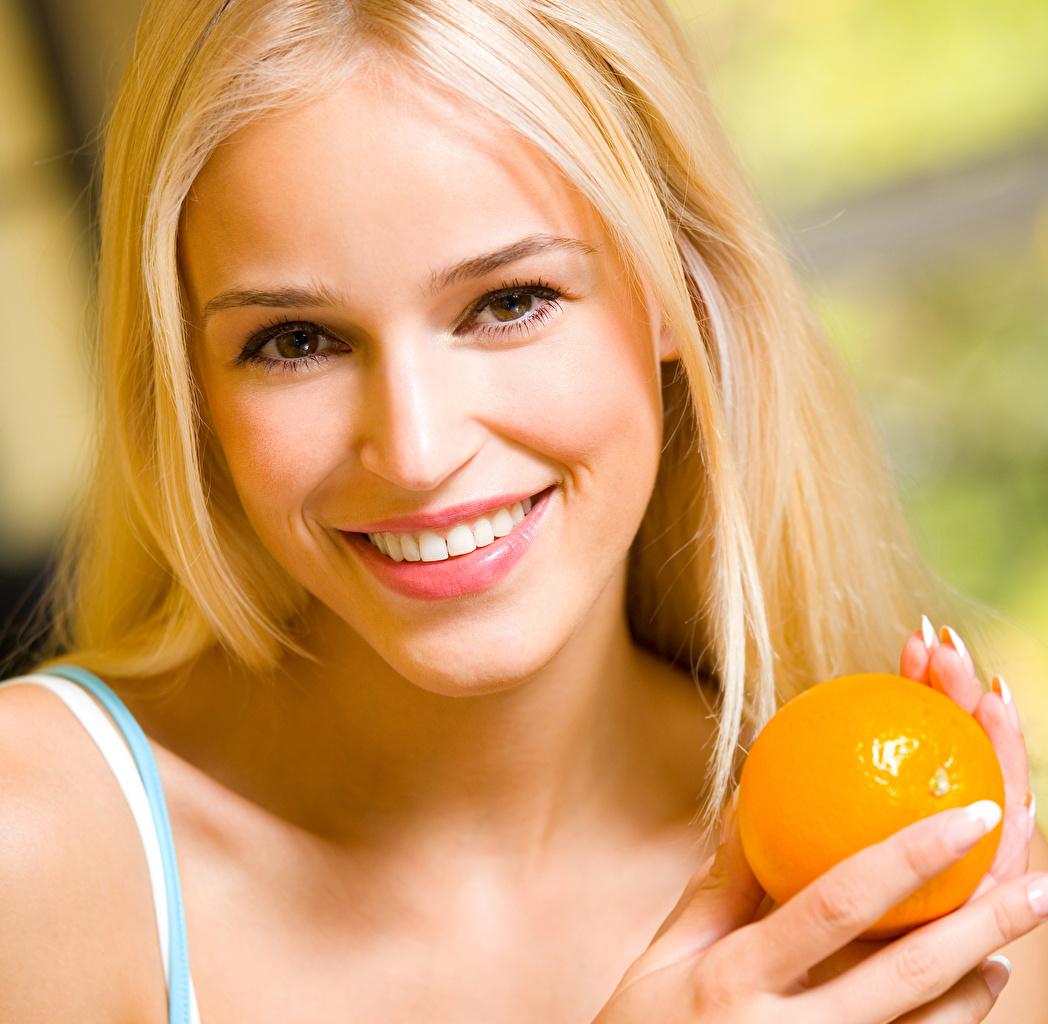 Wallpaper Blonde girl Smile Face Girls Orange fruit female young woman