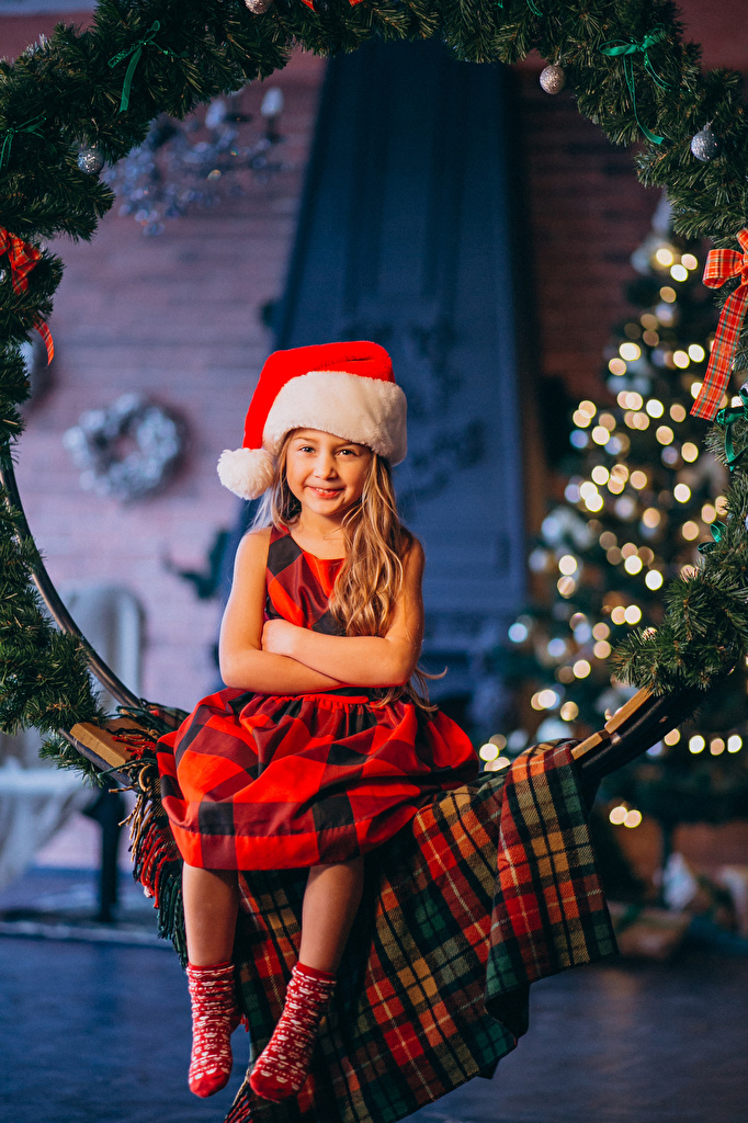 Wallpaper Little girls New year Smile child Winter hat Sitting  for Mobile phone Christmas Children sit
