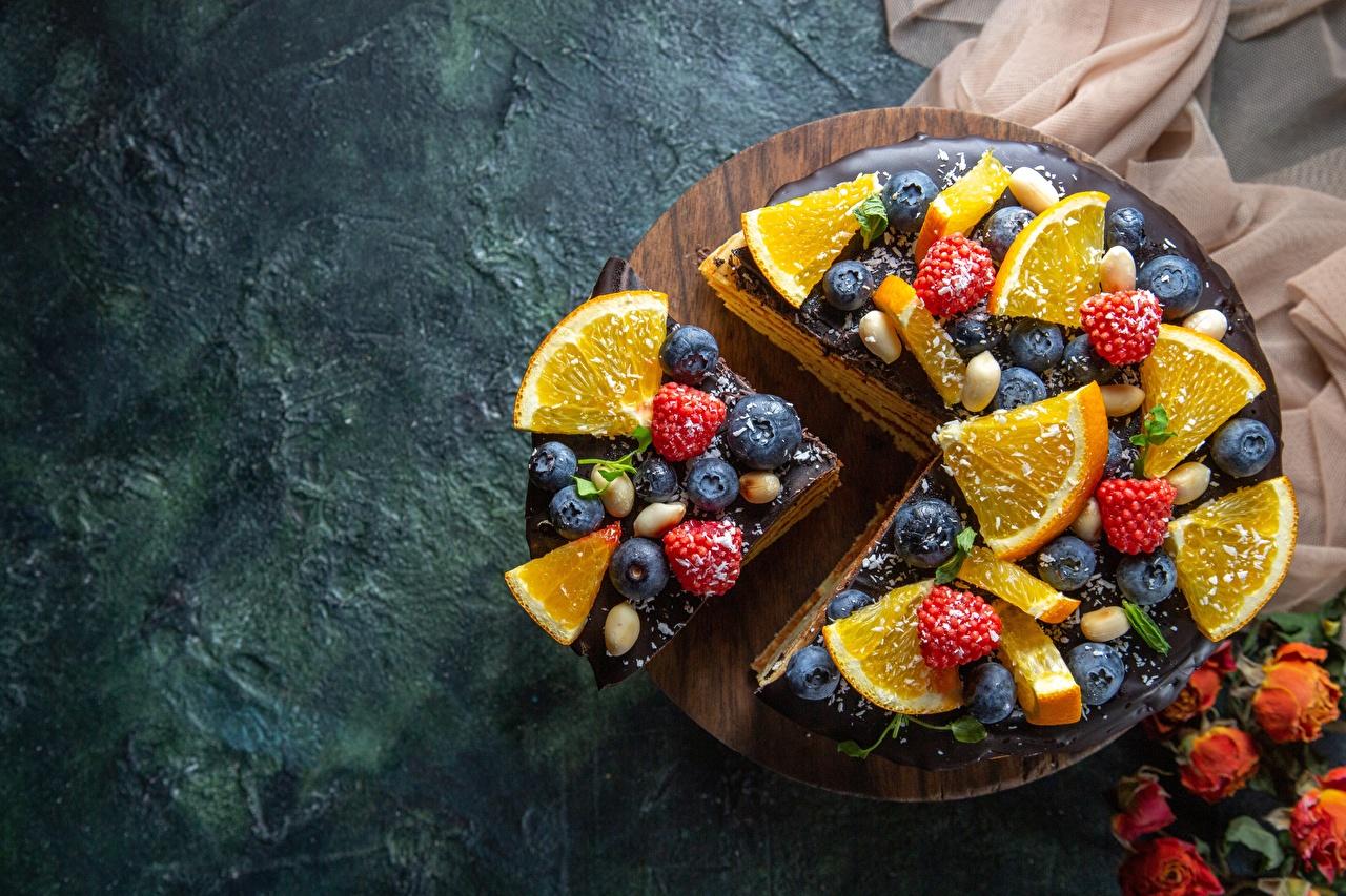 Foto La torta Frutta arancione Pezzo Mirtilli Il lampone alimento pezzi Cibo