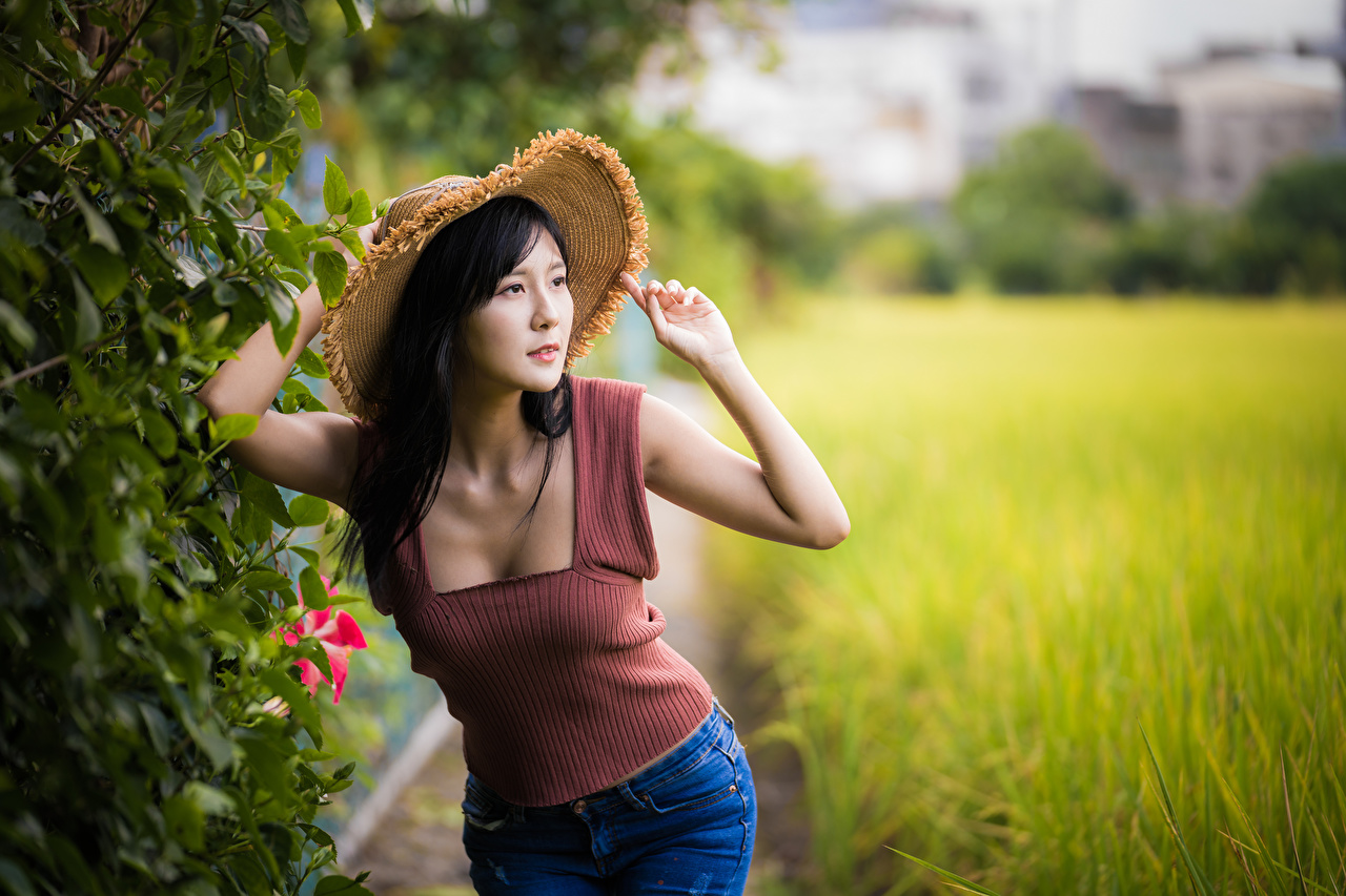 Images Brunette girl Bokeh Hat Girls Asian Singlet Hands blurred background female young woman Asiatic Sleeveless shirt