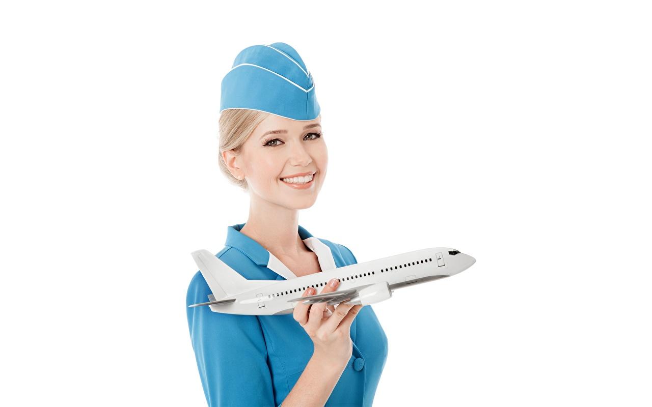Bilder von Flugzeuge Blondine Flugbegleiter Lächeln junge Frauen Weißer hintergrund Blond Mädchen Mädchens junge frau