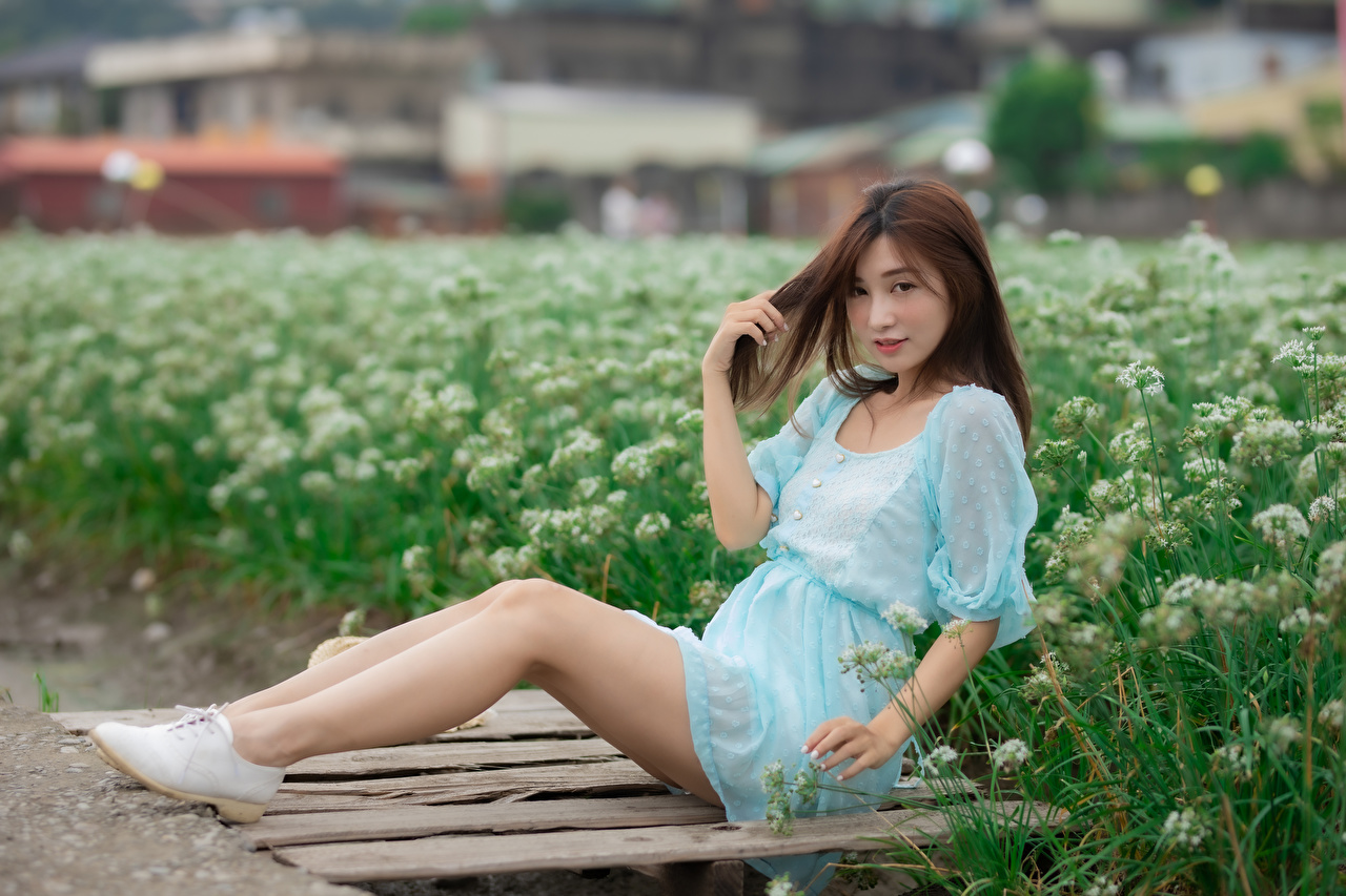 Photos Girls Legs Asian Sitting Glance frock female young woman Asiatic sit Staring gown Dress