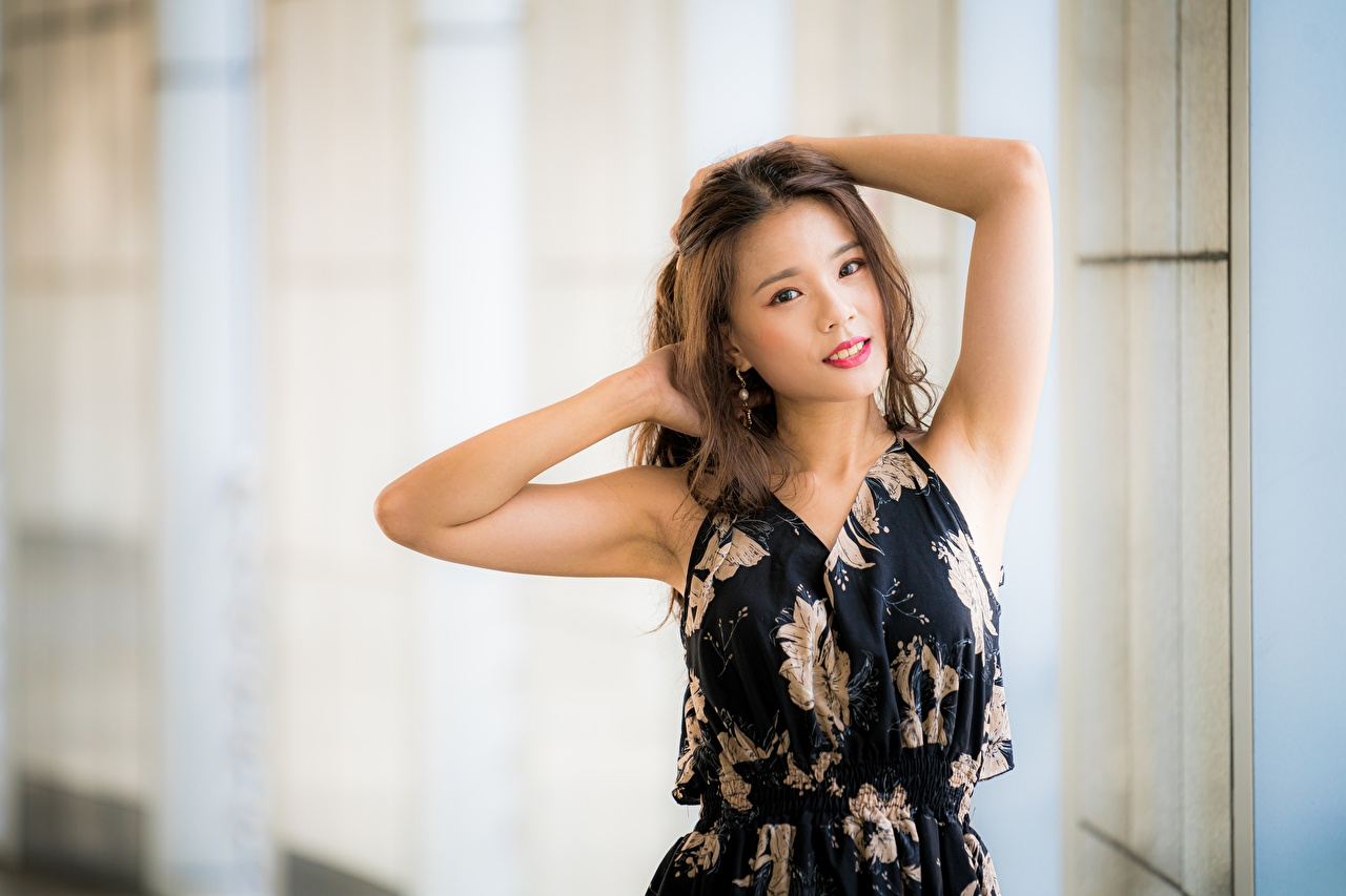 Image Brown haired Bokeh Pose Girls Asiatic Hands Staring Dress blurred background posing female young woman Asian Glance gown frock