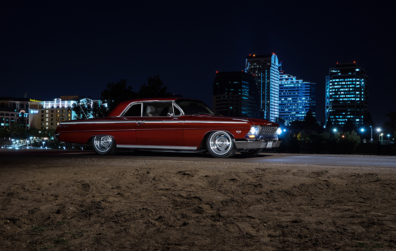Photo Chevrolet Impala 1962 American Muscle Car Red auto Side Night Cars night time automobile