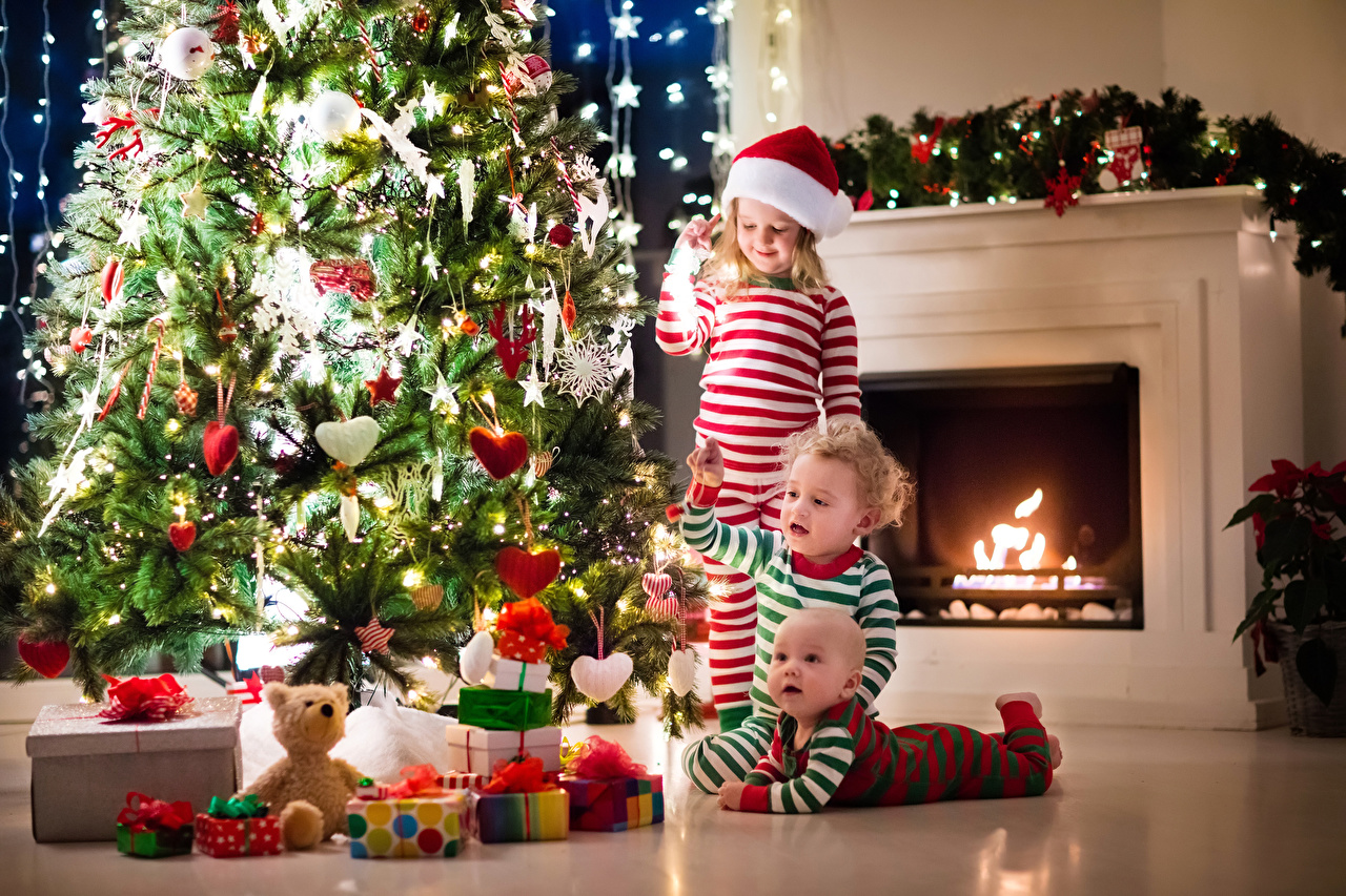 Photos Little girls Boys Infants Christmas Heart Children New Year tree Gifts Balls Three 3 Fairy lights Baby newborn New year child Christmas tree present