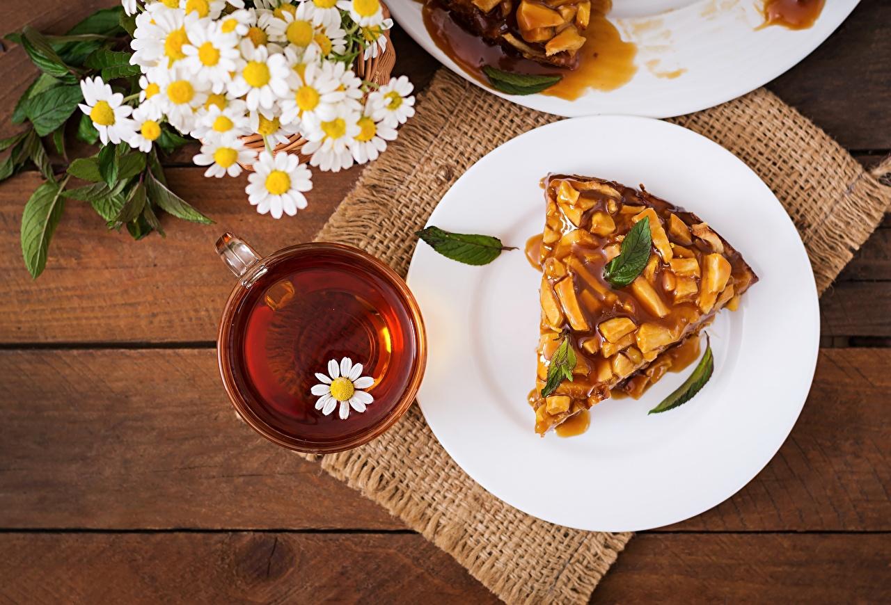 Bilder von Obstkuchen Tee Kamillen Teller das Essen Lebensmittel