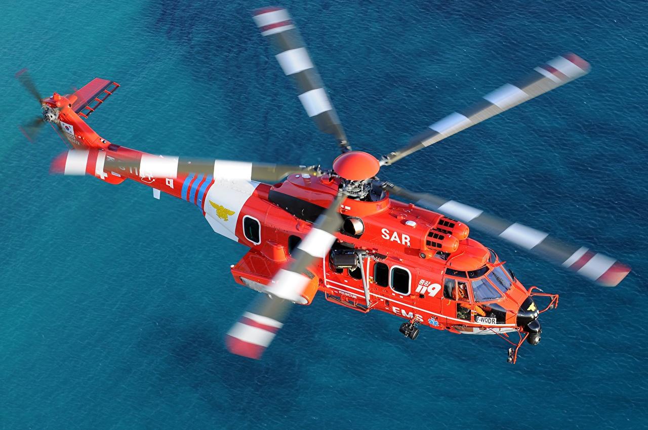 Desktop Hintergrundbilder Hubschrauber Airbus Helicopters H225M Orange Flug Luftfahrt