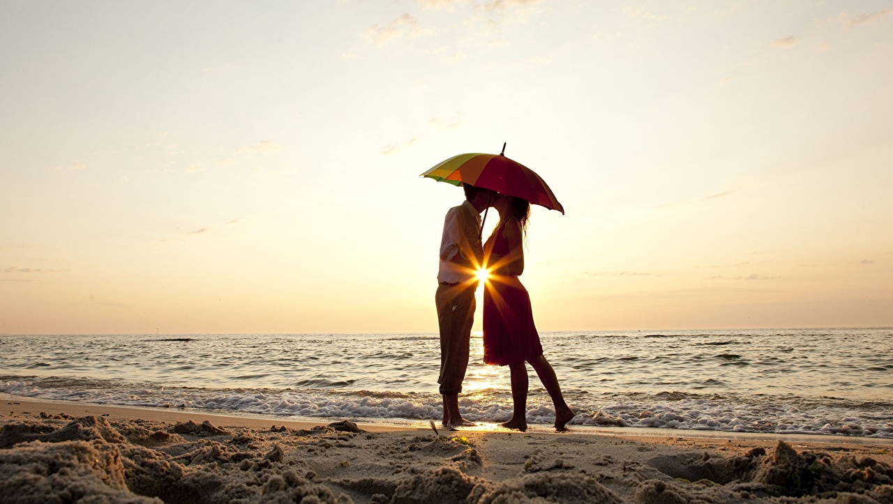 Pictures Rays of light on a date Couples in love beaches Sea People Coast Umbrella Dating lovers Beach parasol