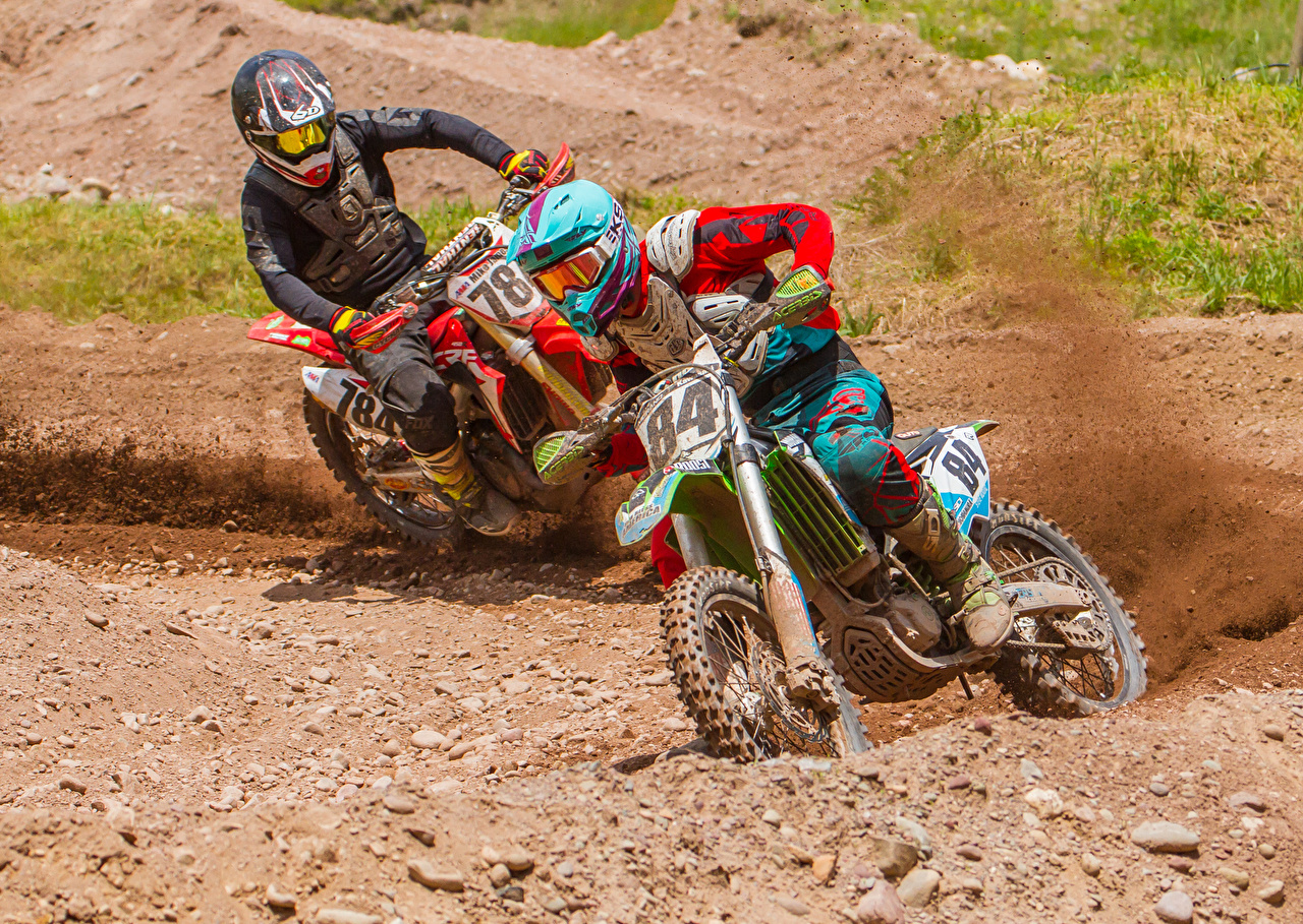 Photo Motocross Helmet 2 Motorcycles Motion Motorcyclist Two motorcycle moving riding driving at speed