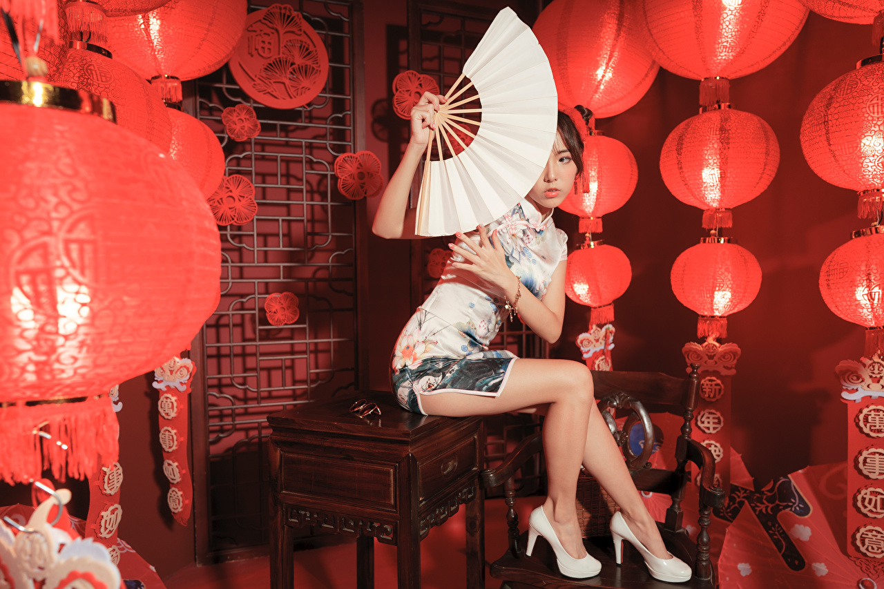 Desktop Wallpapers Hand fan female Legs Asian Sitting Staring gown Stilettos Girls young woman Asiatic sit Glance frock Dress high heels