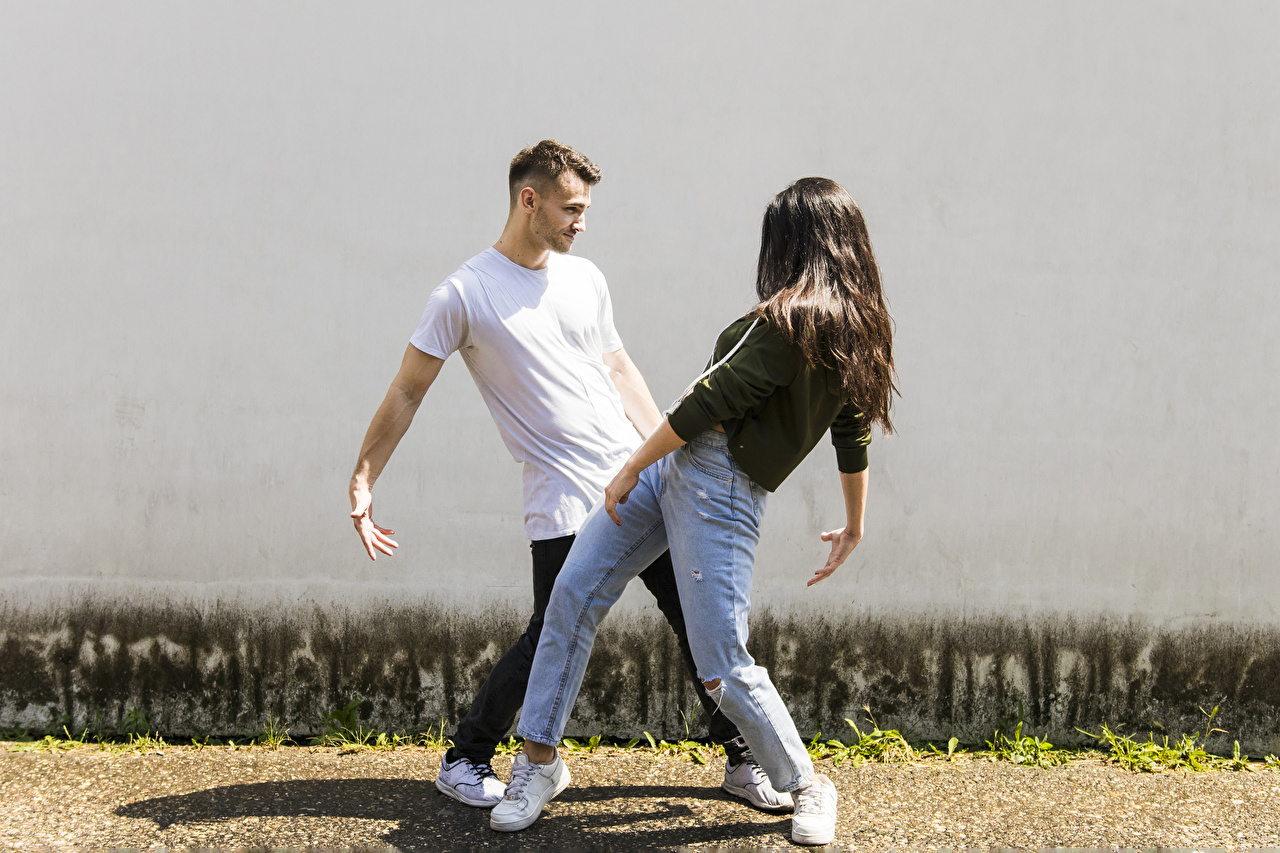 Picture Brown haired Men Dance Two female Jeans Hands Man Dancing 2 Girls young woman