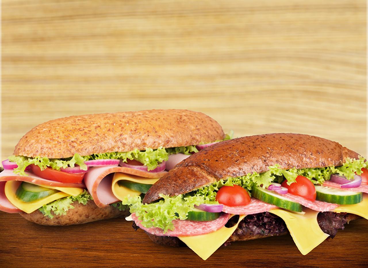 Fotos 2 Wurst Sandwich Brötchen Gemüse das Essen Zwei Lebensmittel