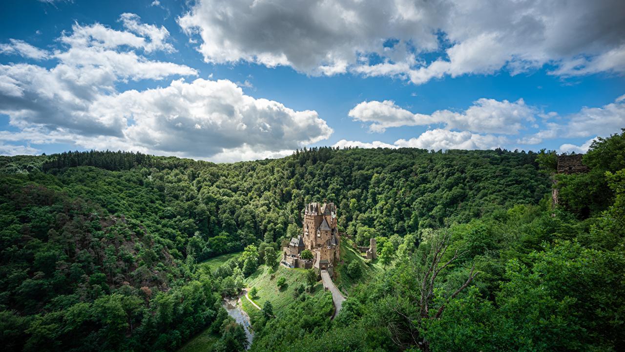 Image Germany Castle Eltz, Rheinland-Pfalz Crag Nature castle Sky Forests Clouds Rock Cliff Castles forest