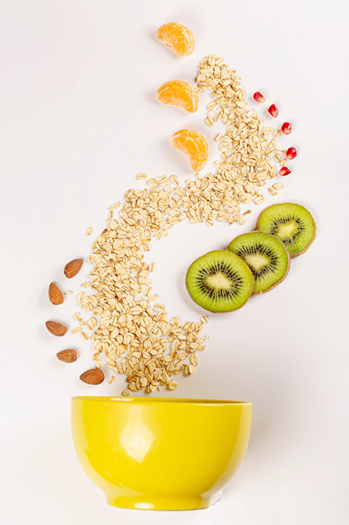 Bilder Haselnuss Haferbrei Kiwi Schüssel Obst das Essen Farbigen hintergrund  für Handy Kiwifrucht Chinesische Stachelbeere Lebensmittel