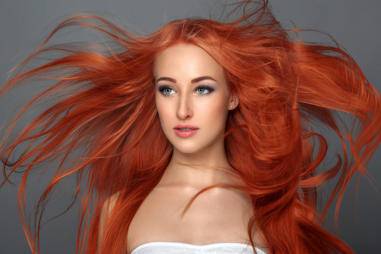 Photo Redhead girl Hair Face Girls Staring Gray background Glance