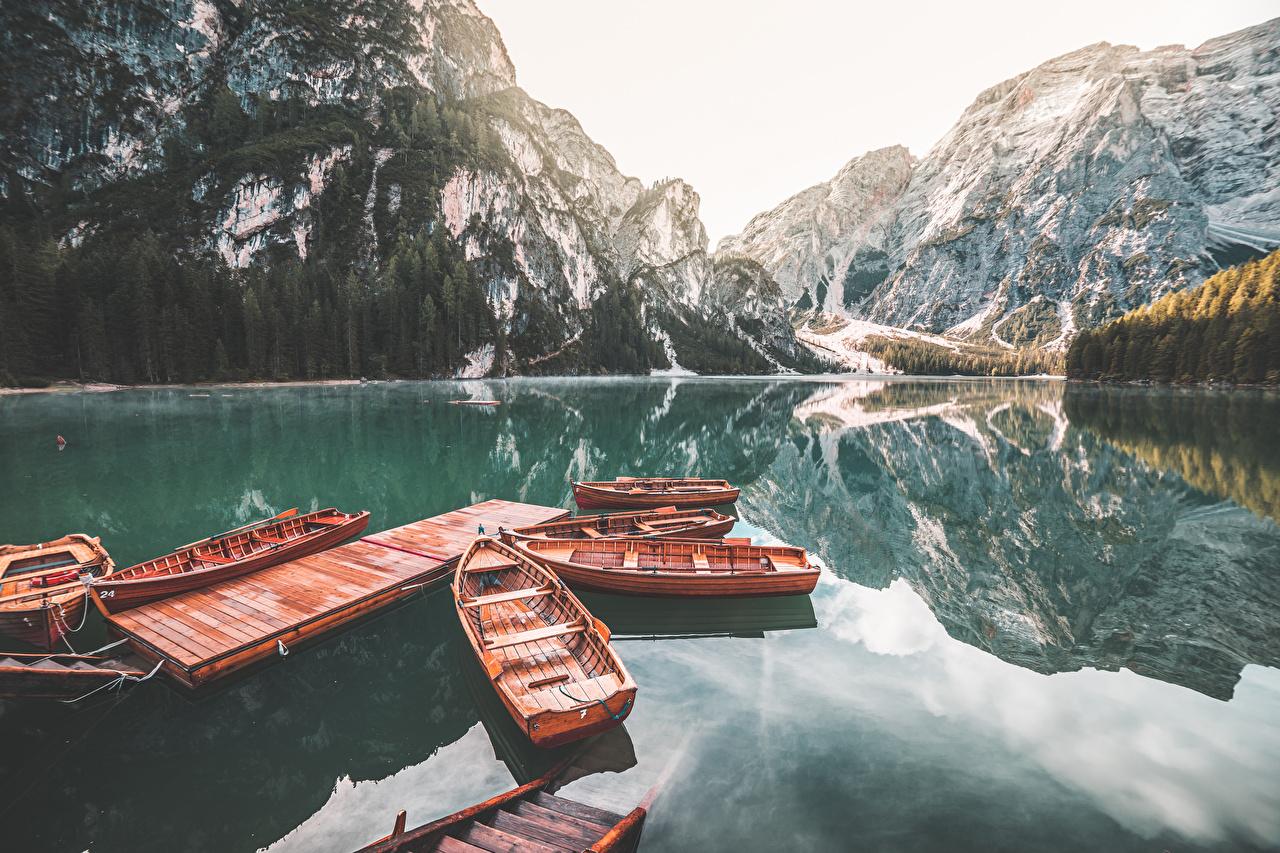Fotos von Italien Lake Braies Natur Gebirge See Boot Seebrücke Berg Bootssteg Schiffsanleger