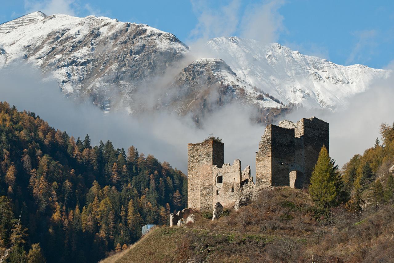Desktop Hintergrundbilder Schweiz Nebel Berg Burg Natur Schnee Ruinen Wälder Gebirge Wald