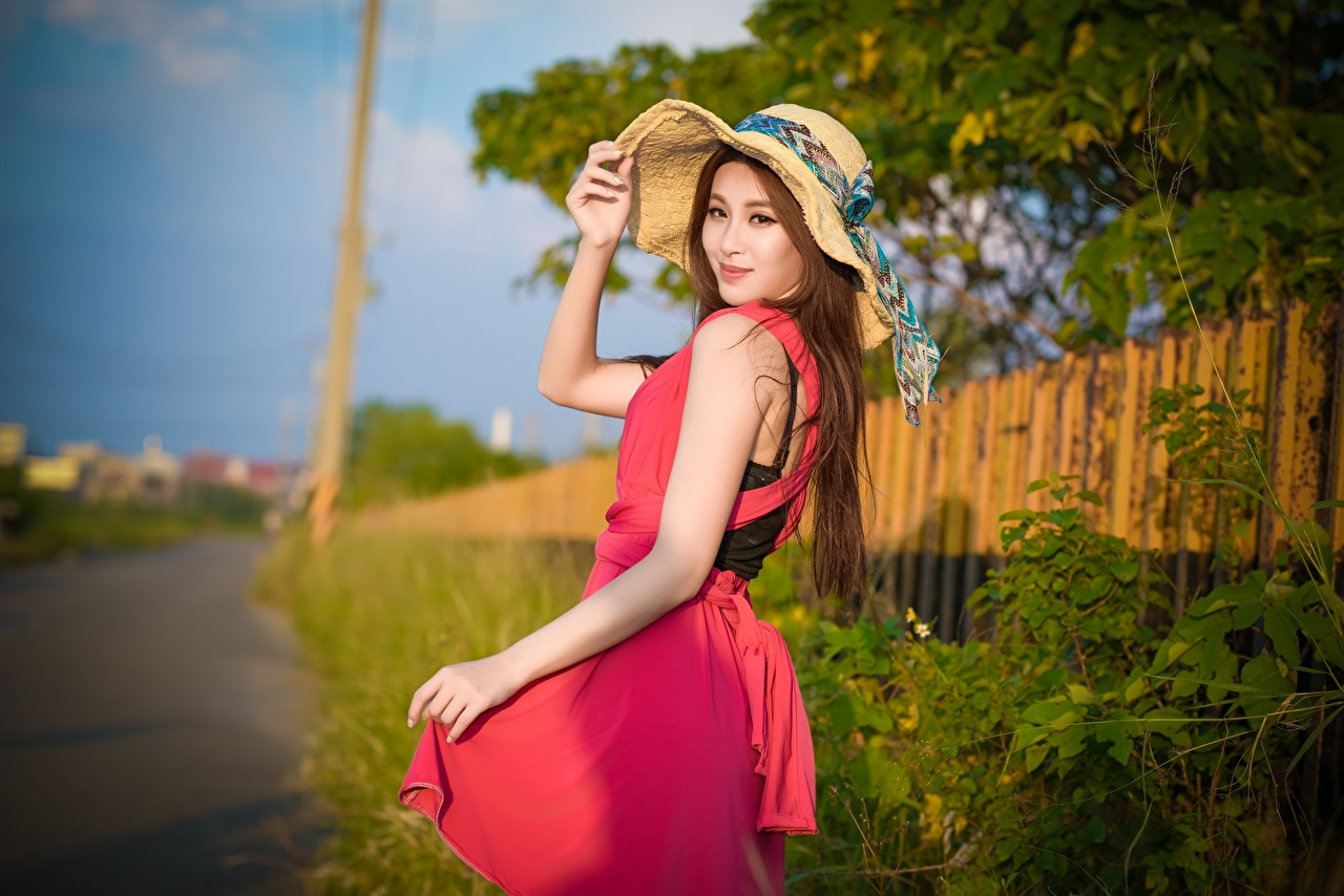 Photos Brown haired blurred background Hat young woman Asiatic Hands Glance gown Bokeh Girls female Asian Staring frock Dress