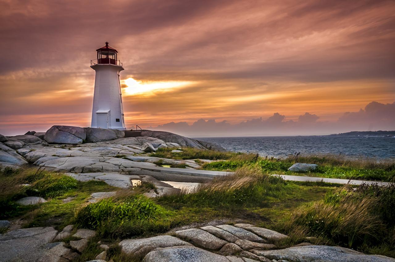 Foto Kanada Peggys Point Lighthouse Natur Leuchtturm Himmel Sonnenaufgänge und Sonnenuntergänge Gras Steine Küste