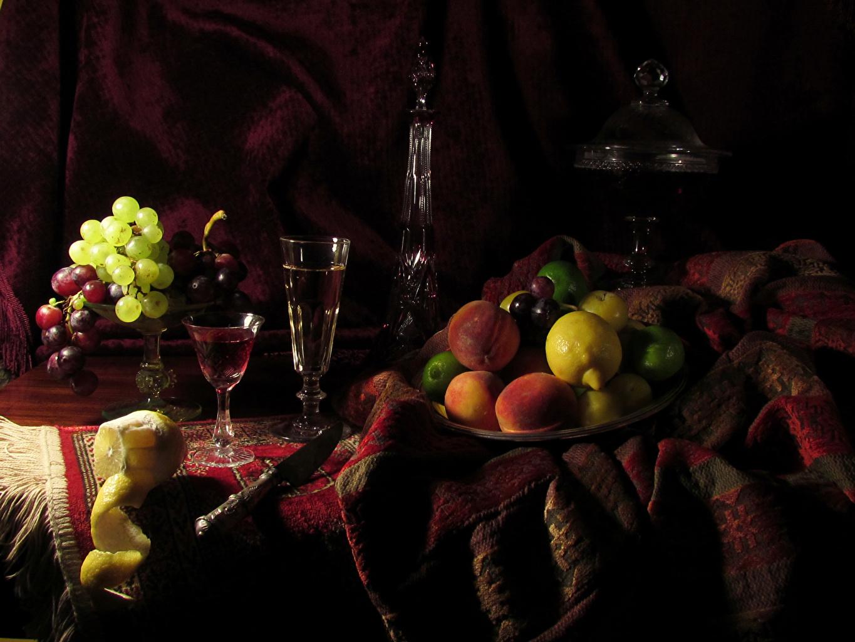 Foto Wein Zitronen Weintraube Obst Flasche Weinglas das Essen Stillleben Zitrone Trauben flaschen Lebensmittel