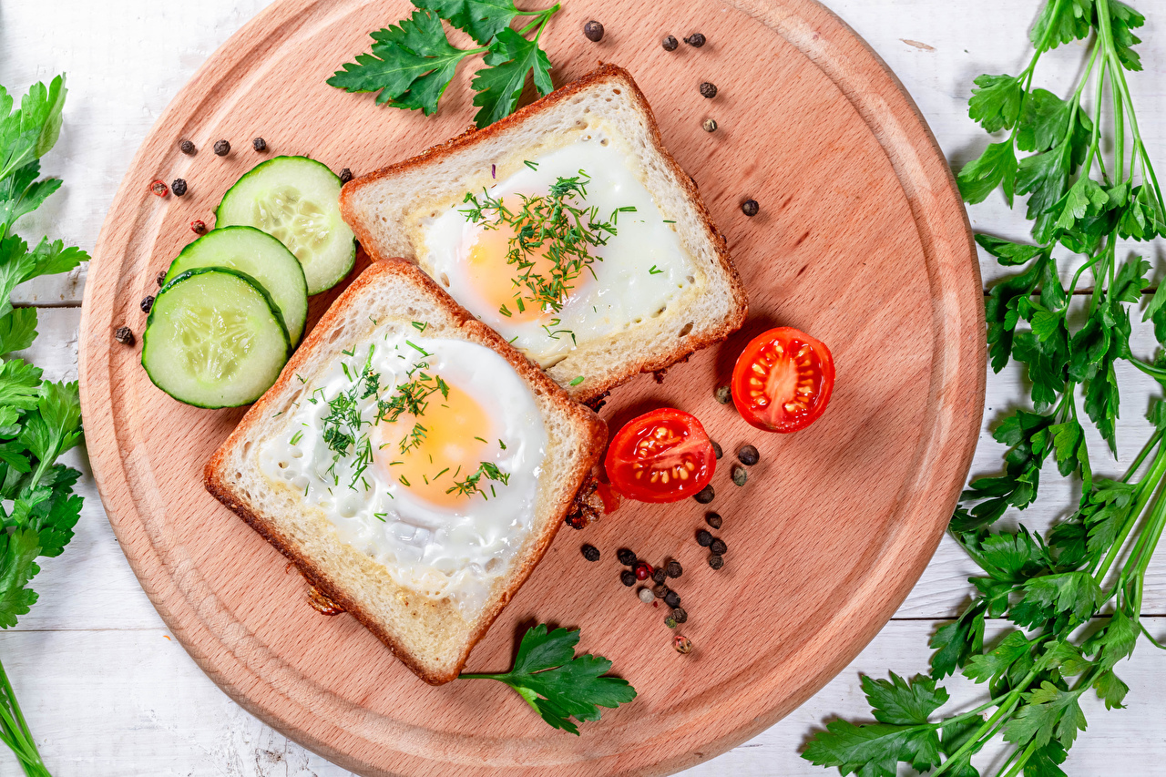 Picture Fried egg Two Tomatoes Cucumbers Black pepper Bread Butterbrot Food Vegetables Cutting board 2
