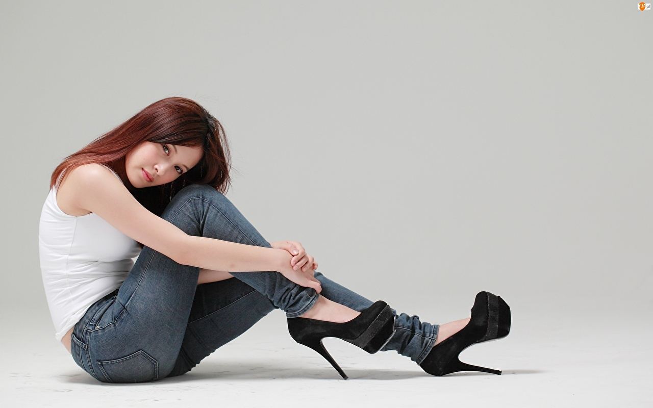 Wallpaper Brown haired Girls Legs Asian Jeans sit Hands Gray background Stilettos female young woman Asiatic Sitting high heels