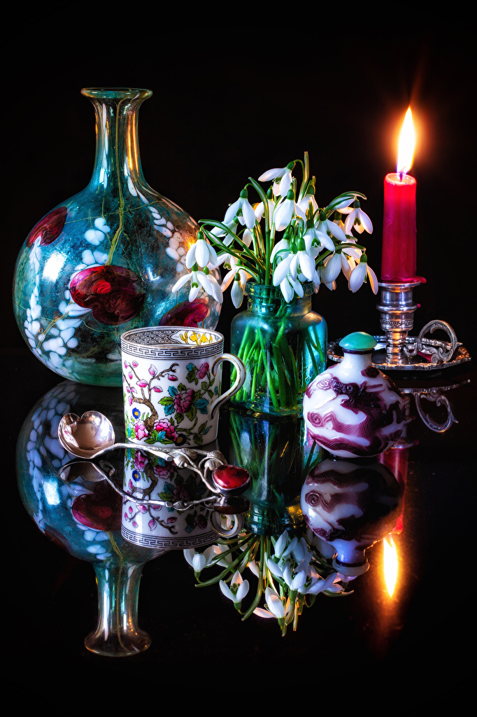 Images Flowers Galanthus Cup Spoon Candles Still-life Black background  for Mobile phone flower Snowdrops