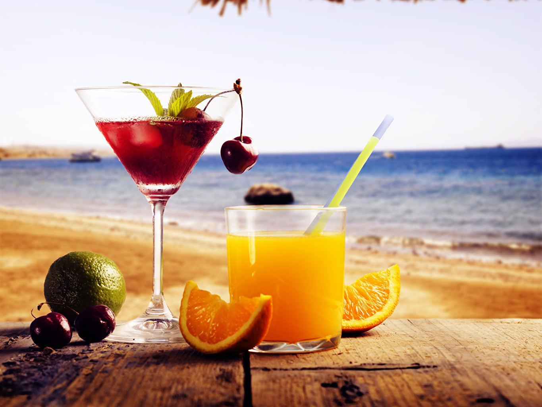 Desktop Wallpapers 2 Sea Juice Orange fruit Cherry Highball glass Food Stemware Drinks Two drink