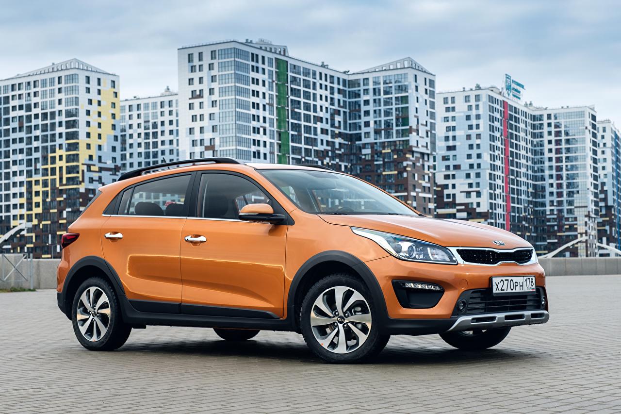 Pictures KIA CUV Orange auto Side Metallic Crossover Cars automobile