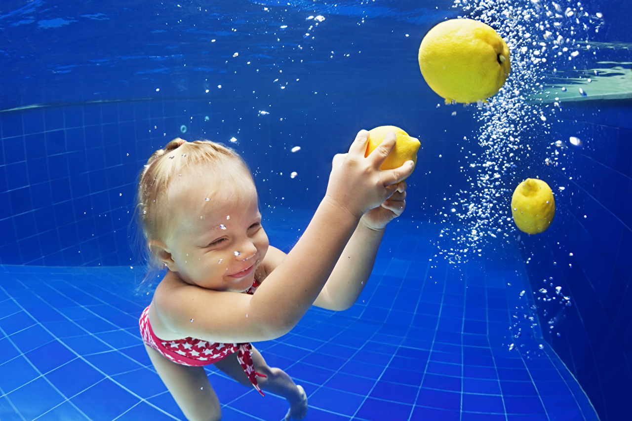 Picture Little girls Underwater world Pools child Lemons Hands Swimming bath Children